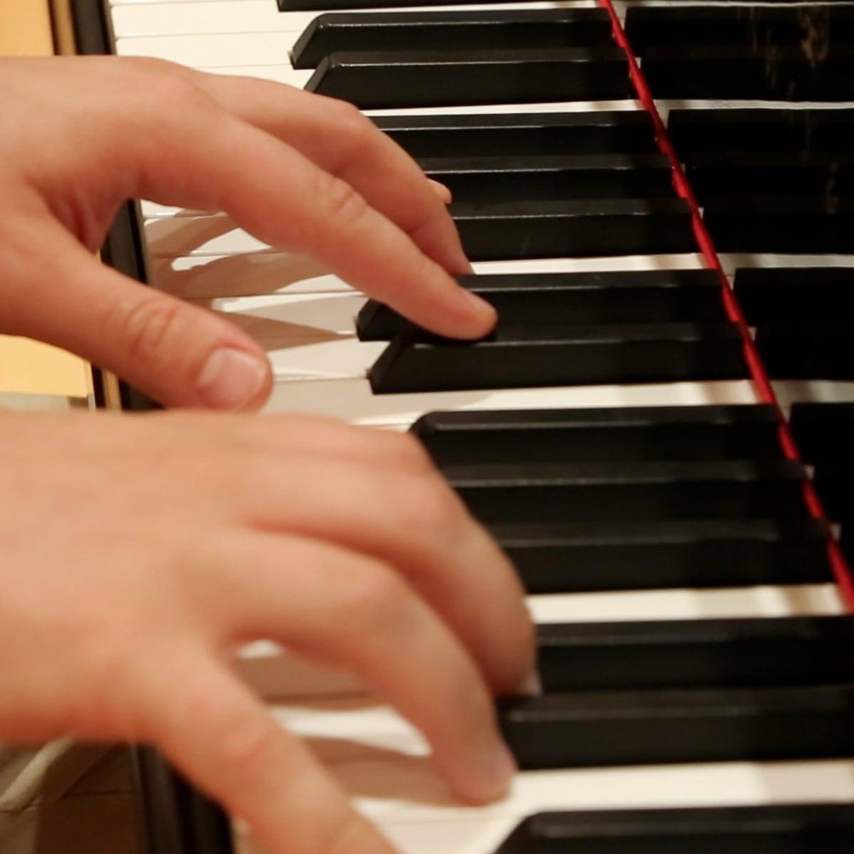 5 Kirill Gerstein prepares piano for Houston Symphony performance September 2013