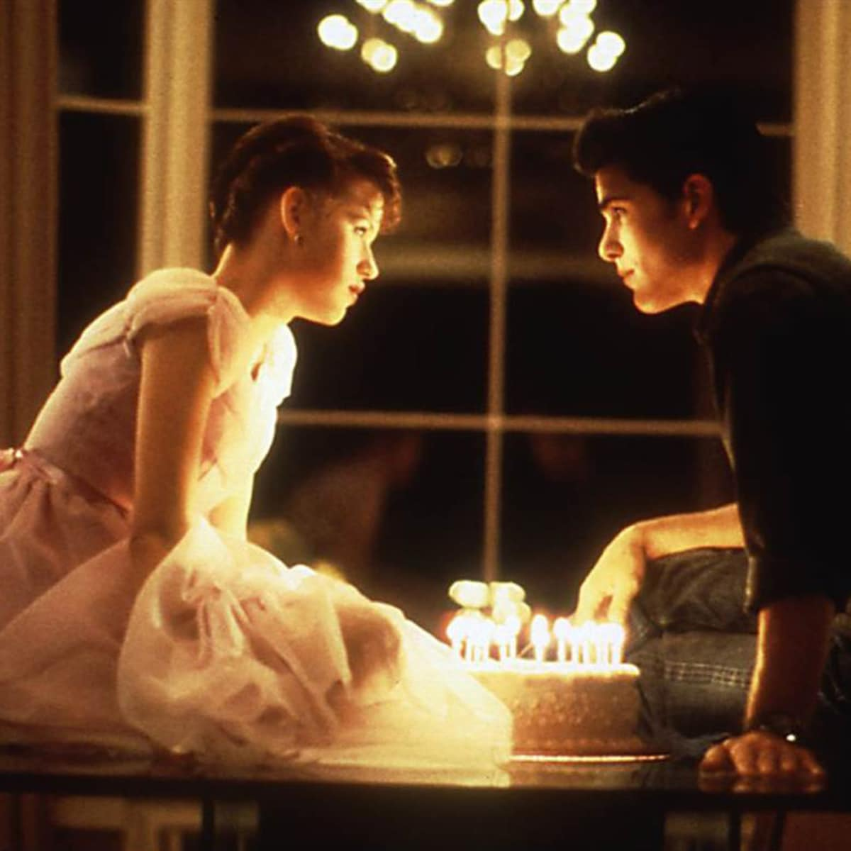 kiss scene from Sixteen Candles between Molly Ringwald and Jake Ryan