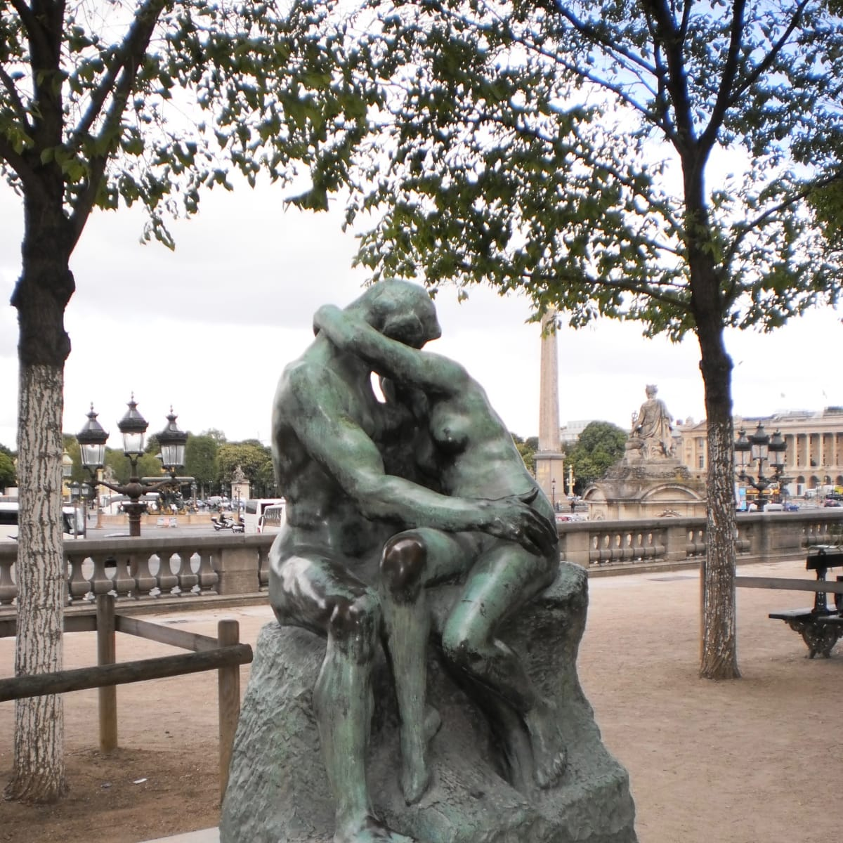 "The lovers in Rodin's ""The Kiss"" sculpture outside Musee de l'Orangerie in Paris"