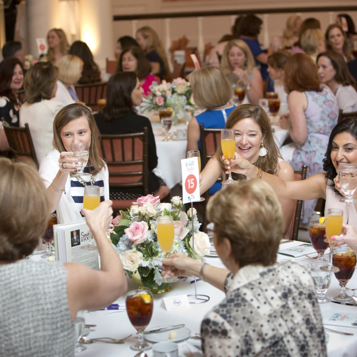 Houston, Spaulding for Children luncheon, May 2017, tablemates toast