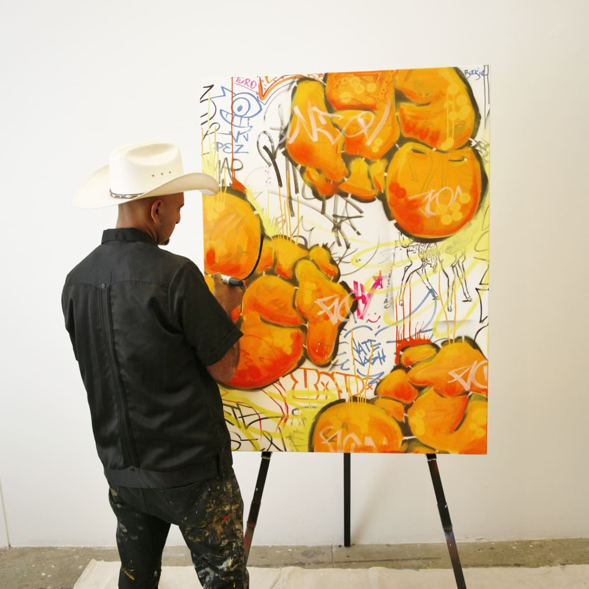 GONZO247 creates a special piece of work live for attendees using his signature style at the Art on the Avenue Preview party.