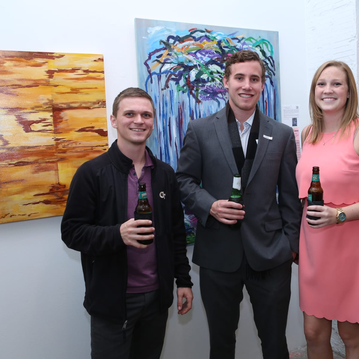 Carl Trovallo, Brian Anderson, Meredith Kendrick take a moment from bidding on artwork to pose for a photo at the 19th annual Art on the Avenue