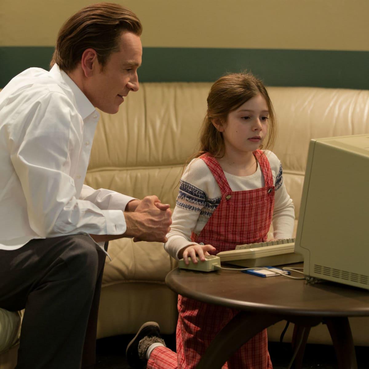 Michael Fassbender and Makenzie Moss in Steve Jobs