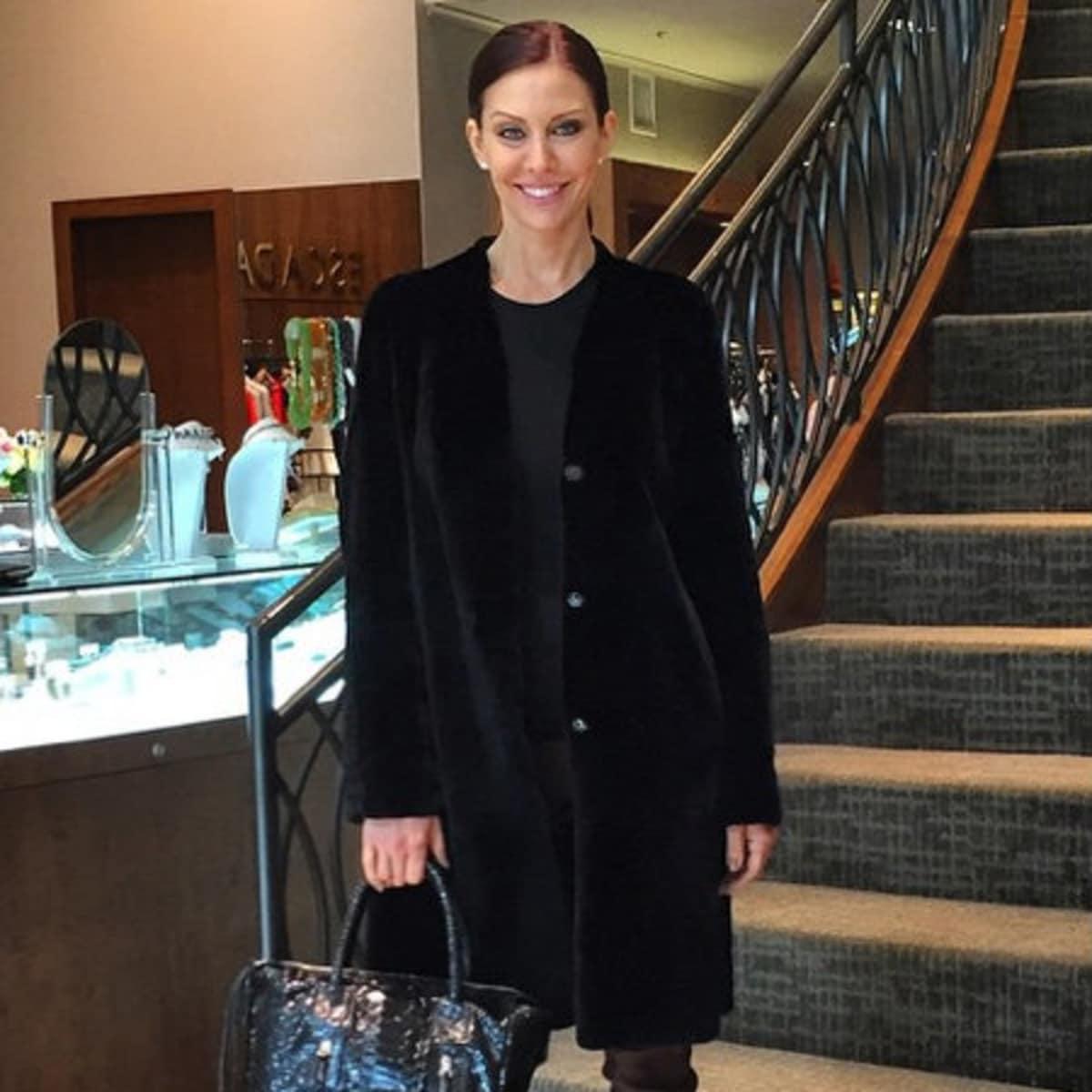 Model in outfit and Carlos Falchi handbag at Elizabeth Anthony