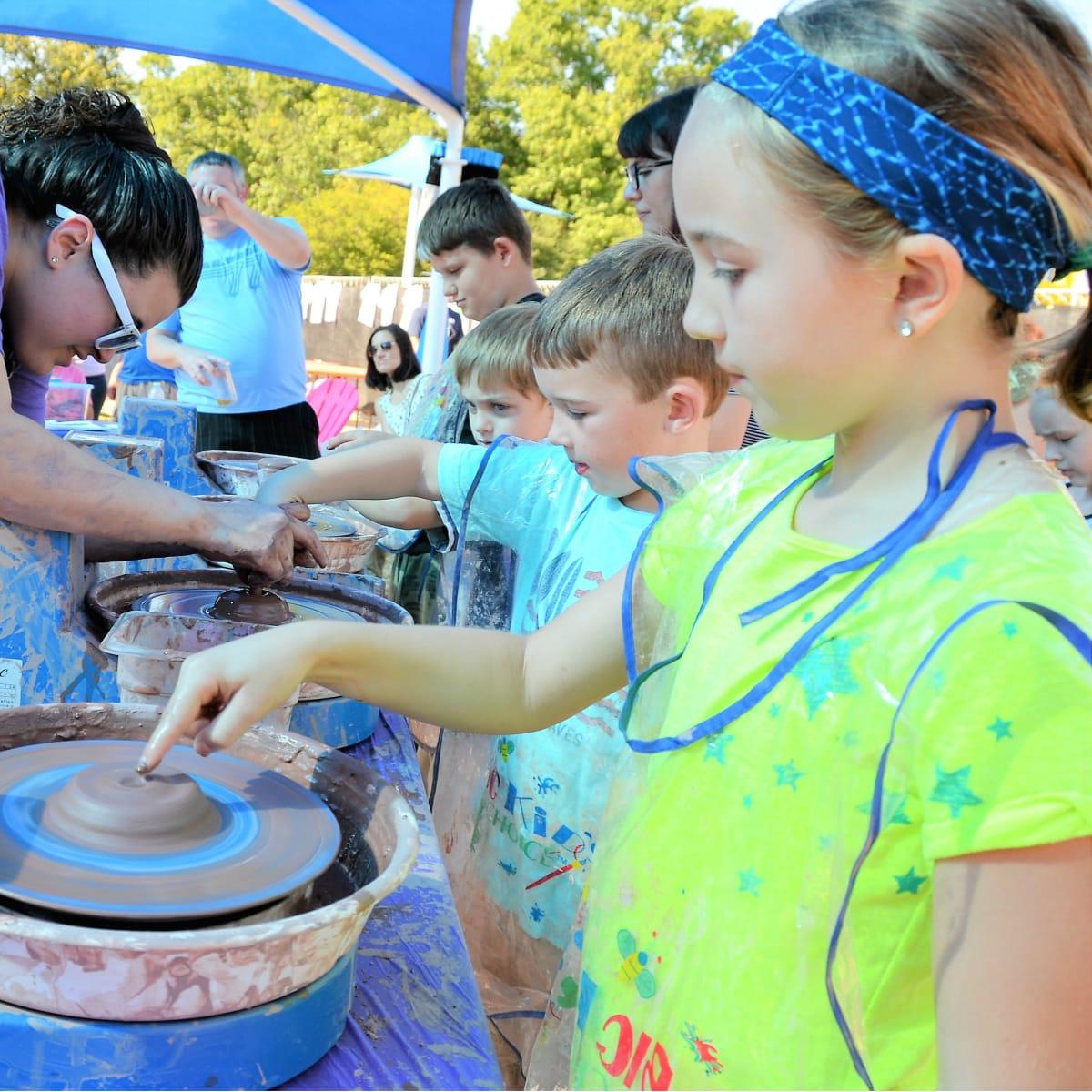 Children making pottery at Cottonwood Art Festival