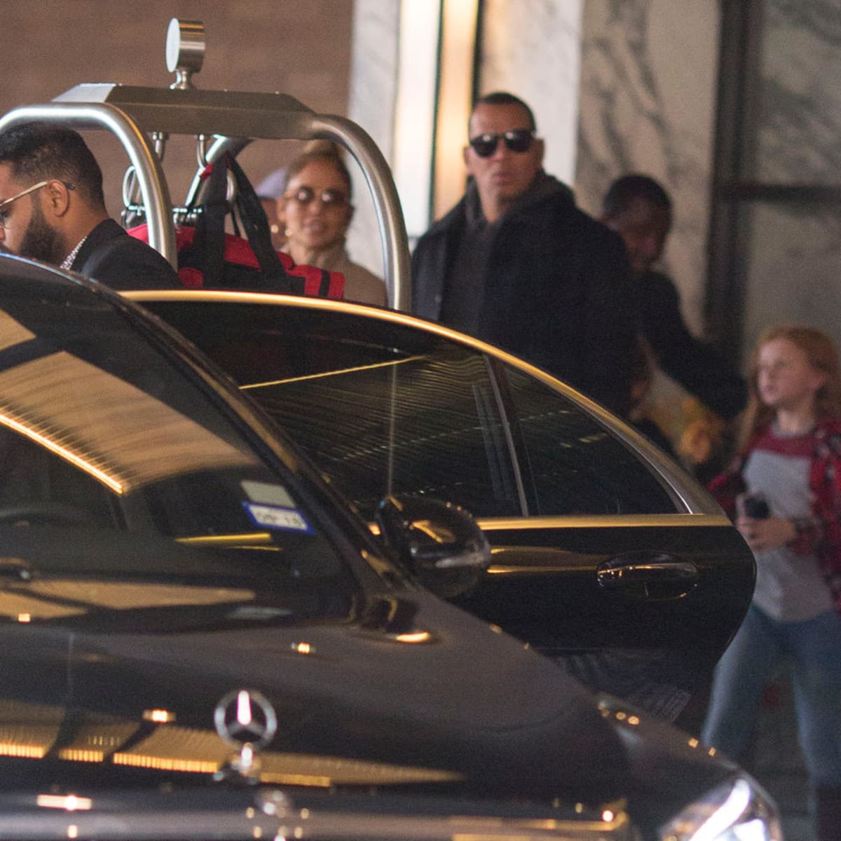 Jennifer Lopez and Alex Rodriguez check out of Four Seasons Hotel after Game 5 of World Series