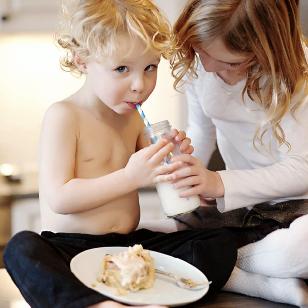 Kids eating RoRo's Cinn-A-Rolls