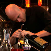 still from SOMM documentary of sommelier with bottle of wine