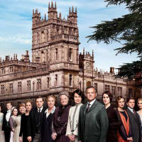 Downton Abbey cast in front of manor