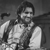 Waylon Jennings performing