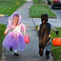 trick or treat children in Halloween costumes