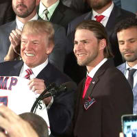 President Trump holding Astros jersey