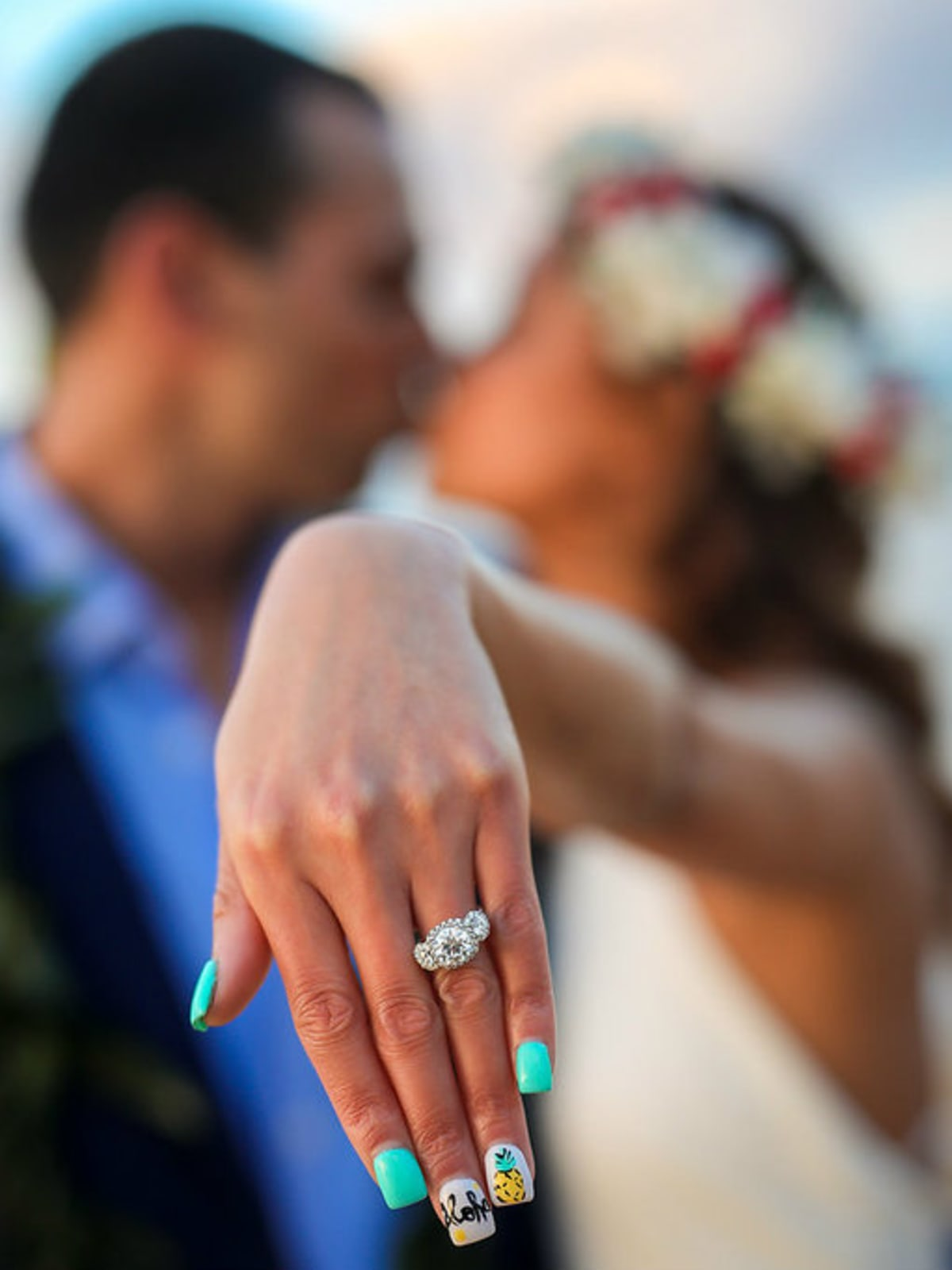 Bride and groom showing off wedding ring
