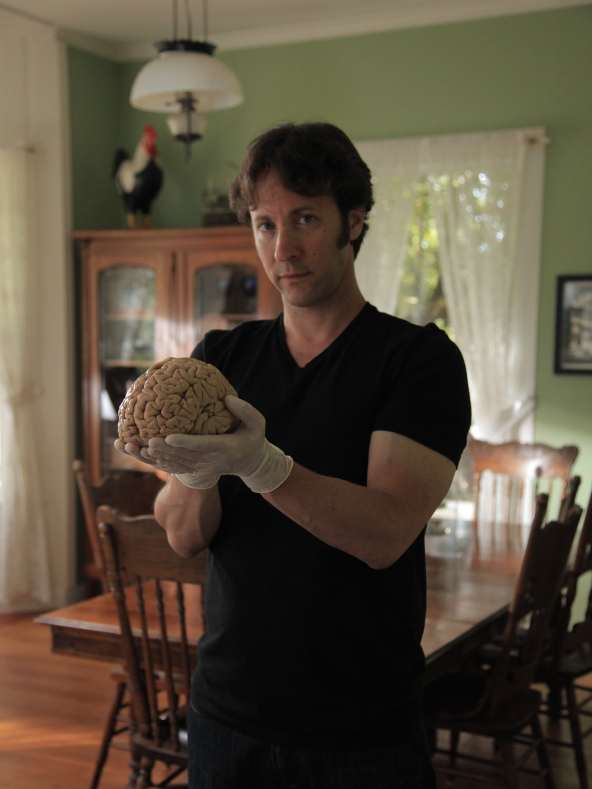 David Eagleman holding a human brain, donated to The M.I.N.D. Institute, University of California at Davis Medical Center for science research