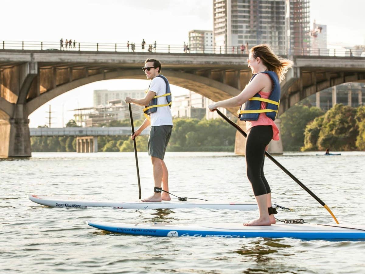 Austin Congress Avenue Bridge paddle board Lady Bird Lake Town Colorado River