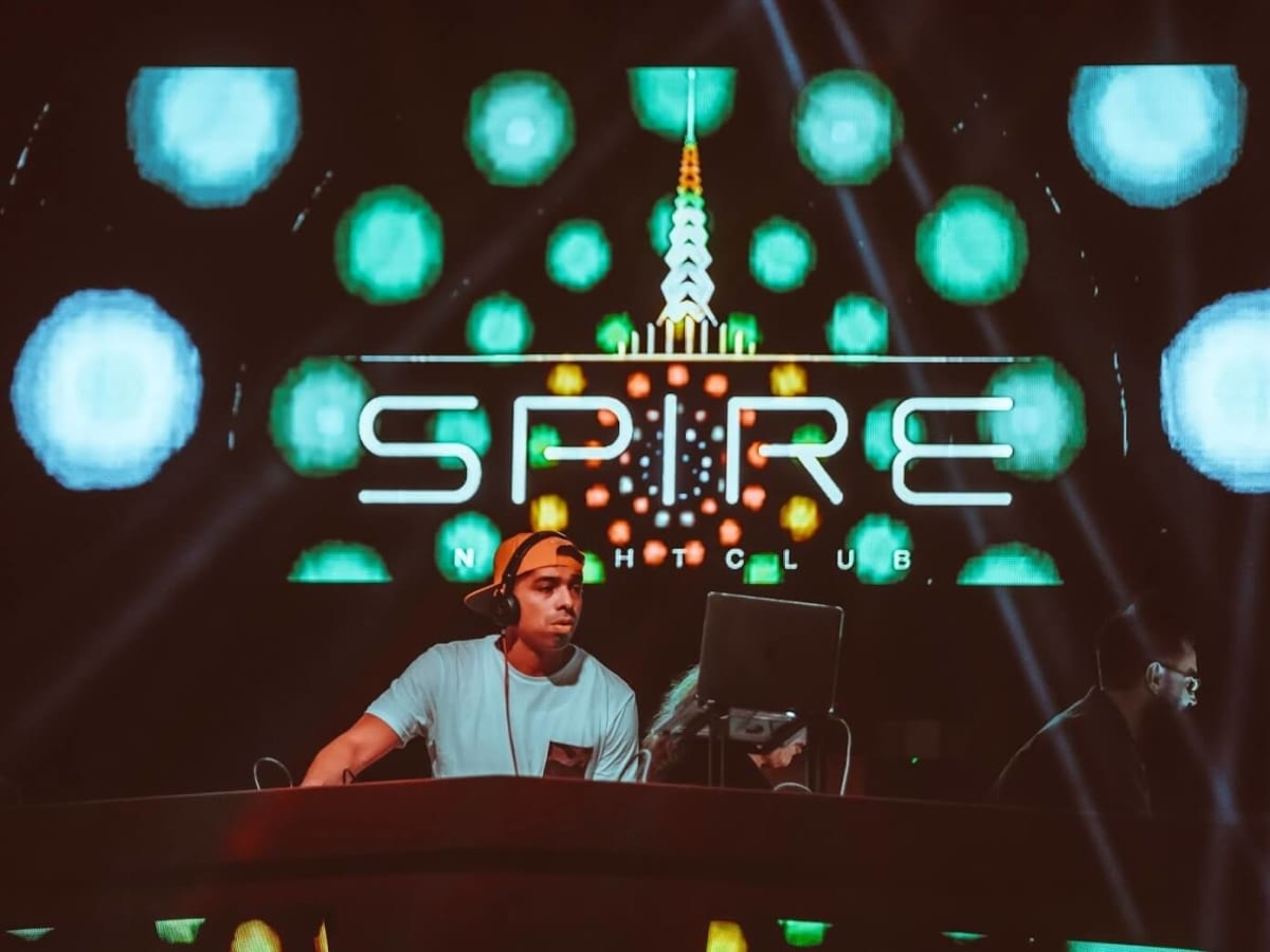 Houston, The Spire, Jan 2017, DJ in front of logo sign