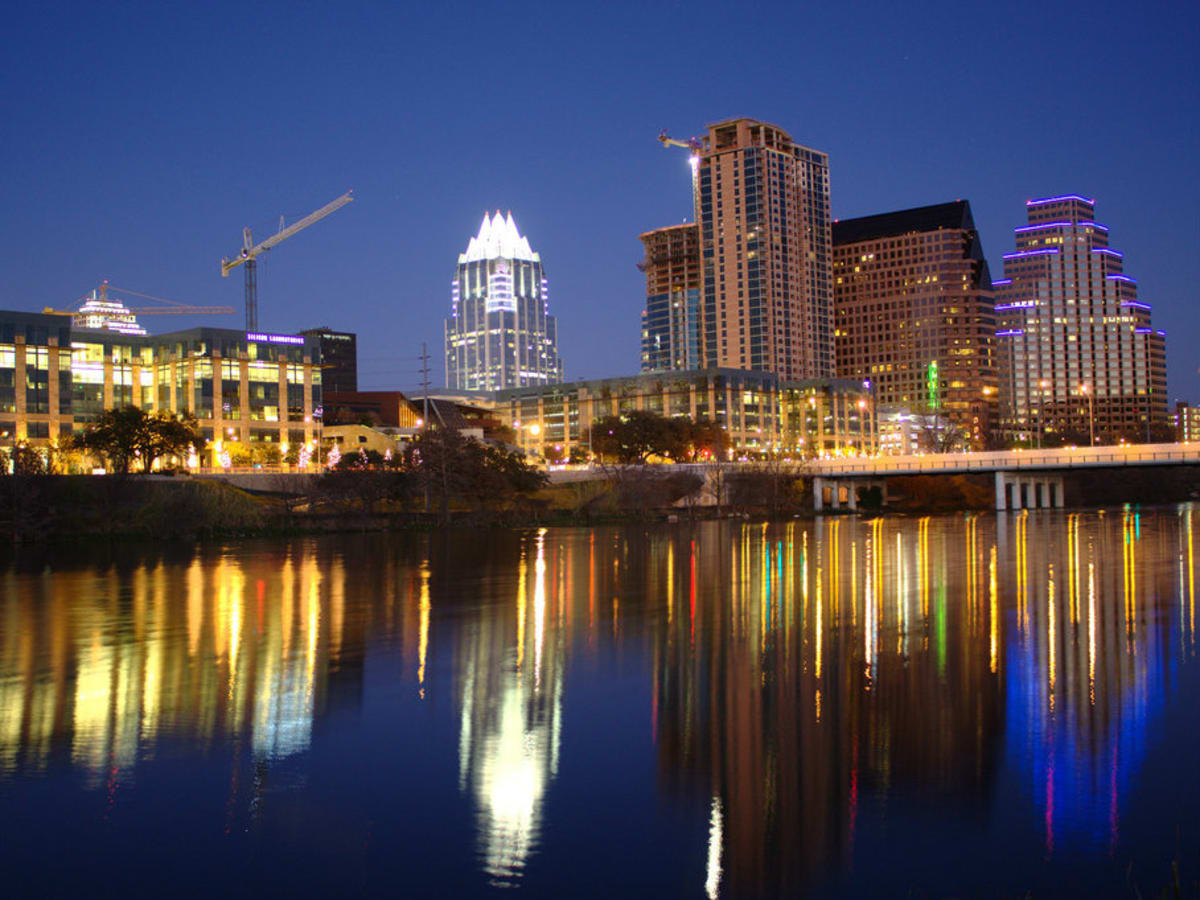 Downtown Austin skyline in the evening across from Lady Bird Lake