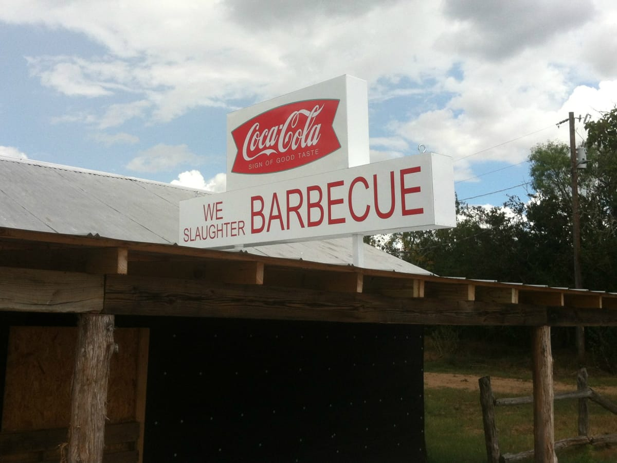 Texas Chain Saw Massacre Gas Station We Slaughter Barbecue restaurant resort sign