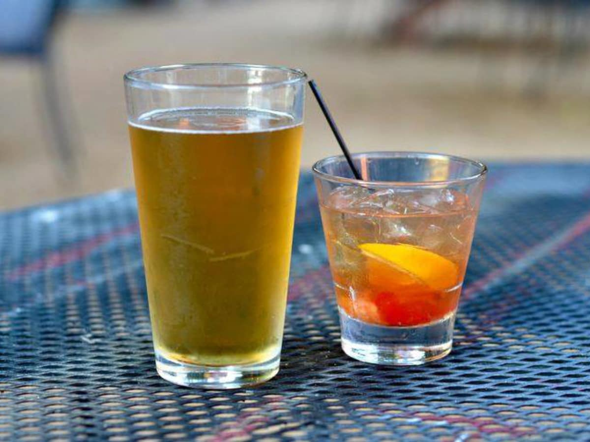 Drinks on a patio table at Eight Bells Alehouse