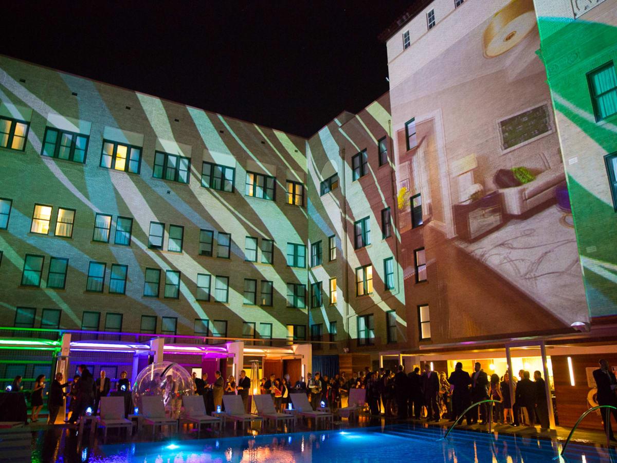 The Saint Anthony Hotel San Antonio Grand Reopening 2015 pool bar ball acrobat