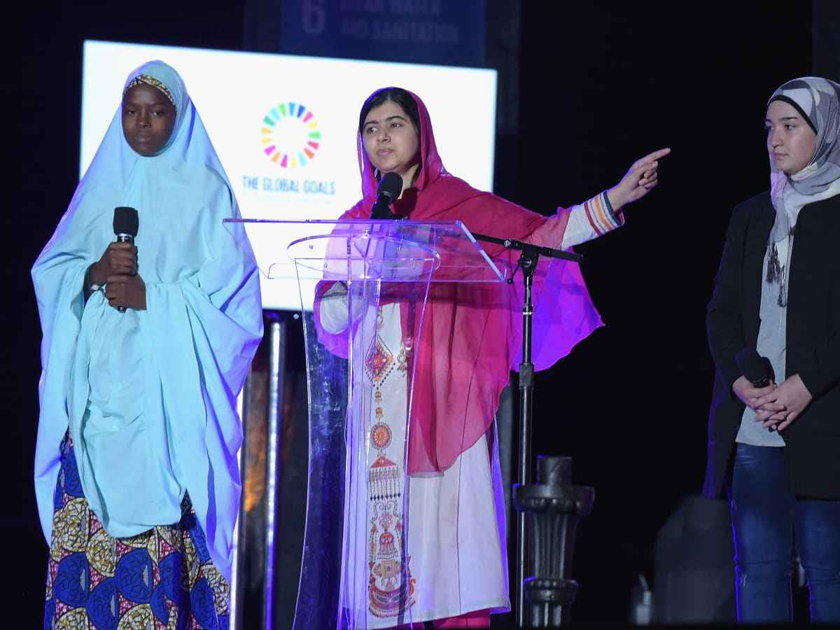 Activist Malala Yousafzai speaks on stage at the 2015 Global Citizen Festival