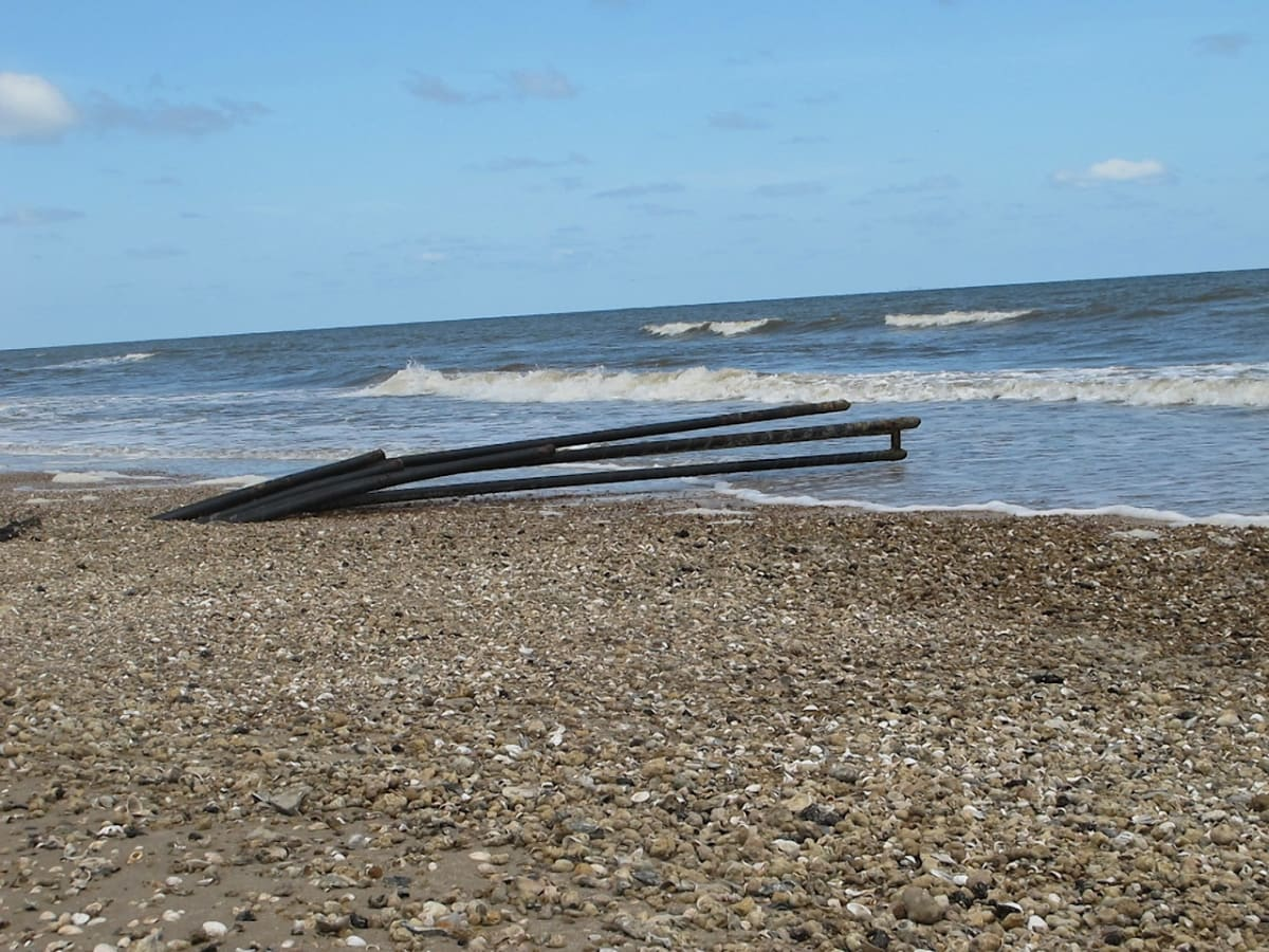 Pipes leading to Gulf at Bolivar Peninsula