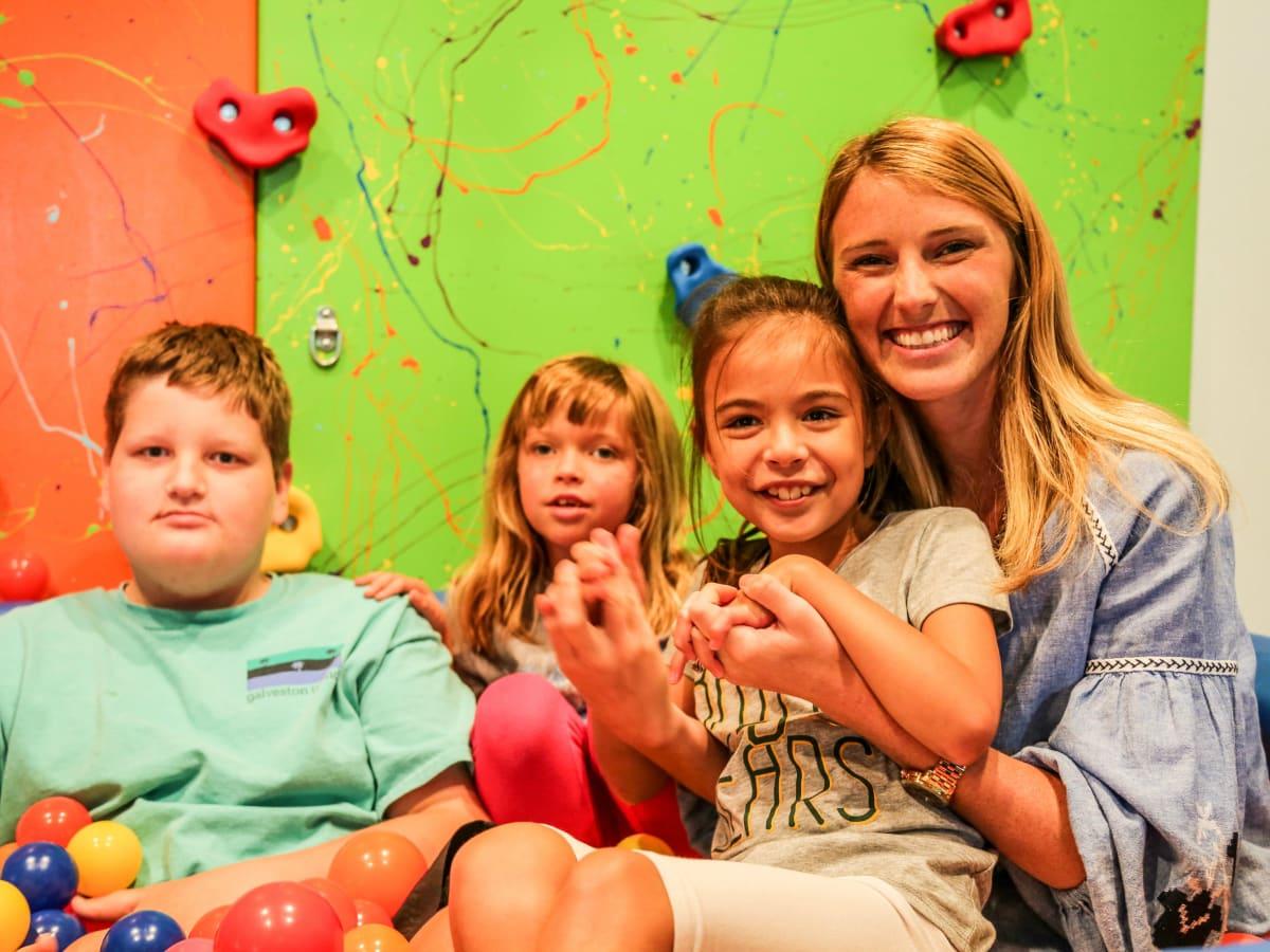 Katelyn Barbier-Mueller with children from Cornerstone Achievement Center