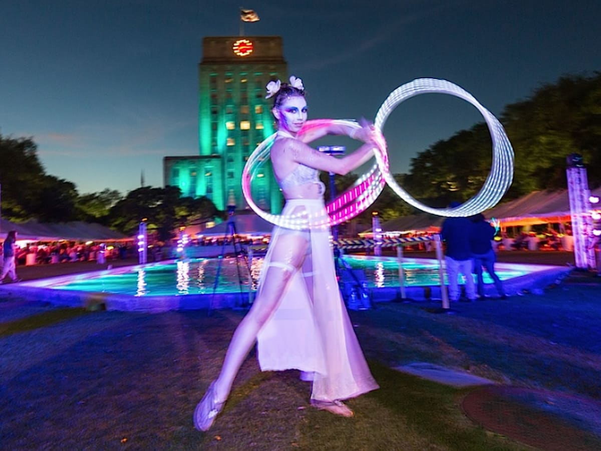 Bayou City Burlesque entertained around the City Hall reflection pool during the Legendary Art Car Ball
