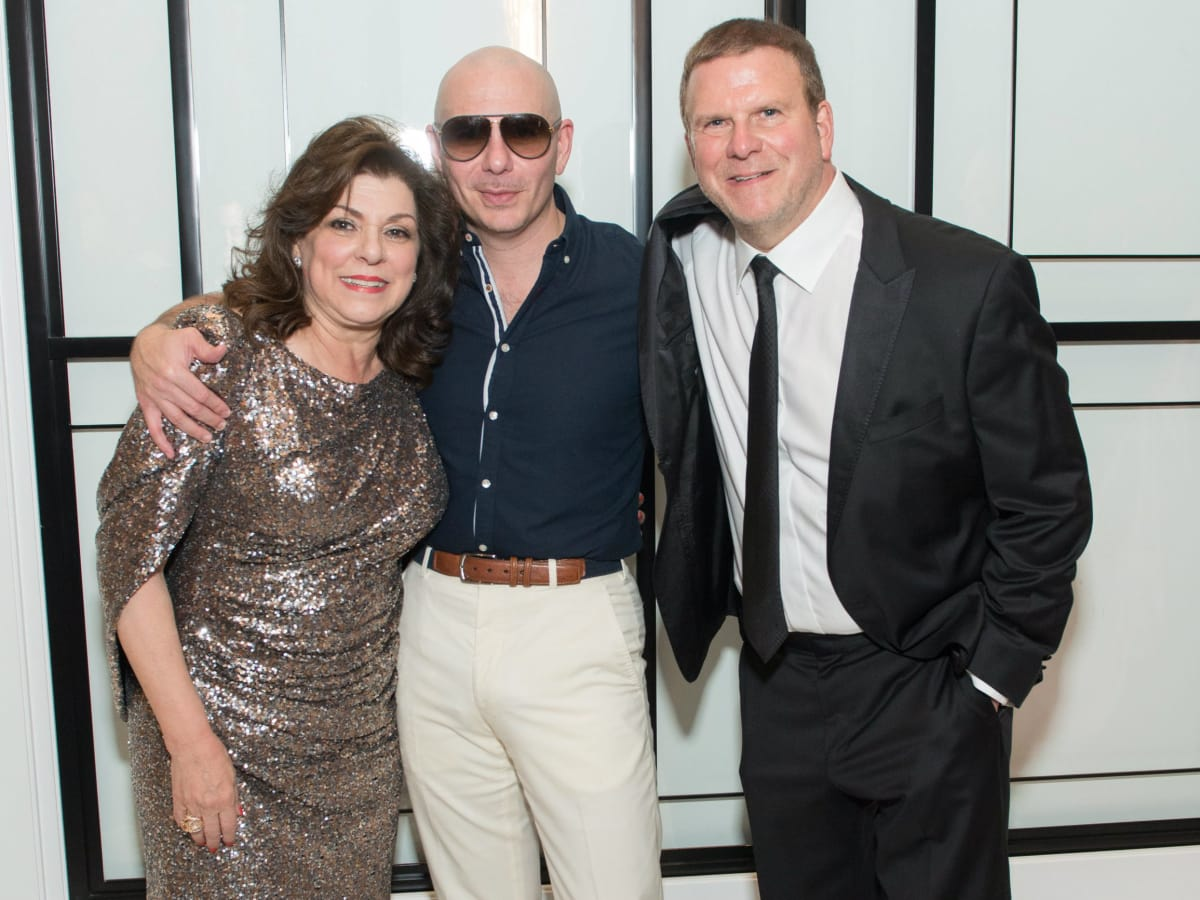 Laura Ward, Pitbull, and Tilman Fertitta