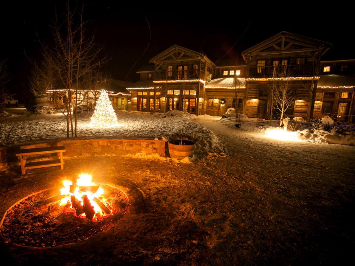 Hoffman - travel - Montana Ranch at Rock Creek - exterior cabin and fire