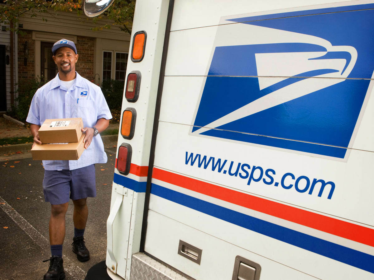 United States postal service mail carrier delivery person mail man