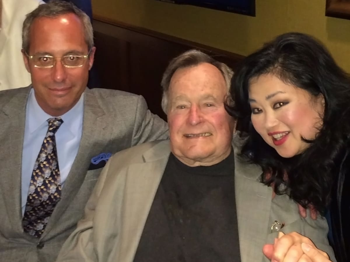 Mark Sullivan, from left, George H.W. Bush and Gigi Huang at the George H.W. Bush party April 2014