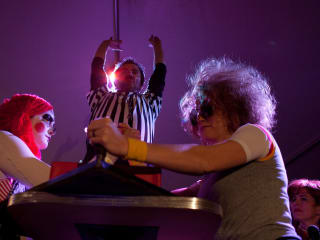 performers and referee from the Collective of Lady Arm Wrestlers CLAW