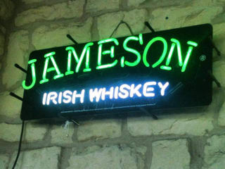 neon Jameson Whiskey sign in Opal Divine's Penn Field