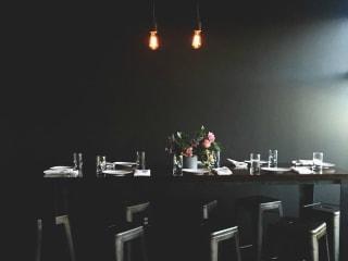 Apothecary Cafe & Wine Bar Austin restaurant interior table