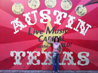 Mickey Avalon in from of live music capital mural shirtless
