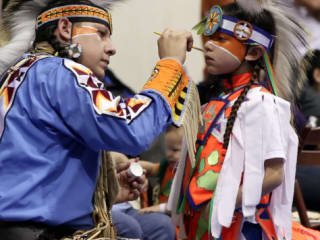 American Indian Heritage Festival participants painting faces for Austin Powwow