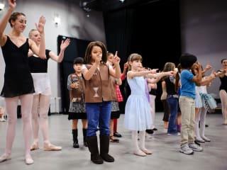 kids and teacher in family dance workshop at Ballet Austin