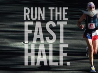 old man with long beard running in 3M Half Marathon