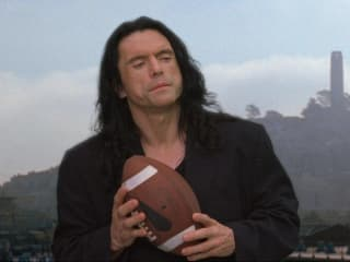 Tommy Wiseau in The Room with a football