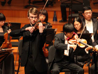 student violinists performing during Menuhin Competition