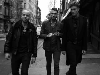 new york band The Kin walking down a street