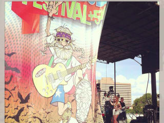 poster and stage at Keep Austin Weird Fest and 5K