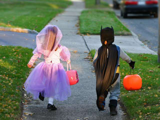trick or treat children in Halloween costumes