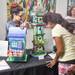 Trish Motolinia and Harralyne Landrove check out the celebrity birdhouse by Sharon Kopriva and Chris Silkwood at Sawyer Yards Artist Stroll