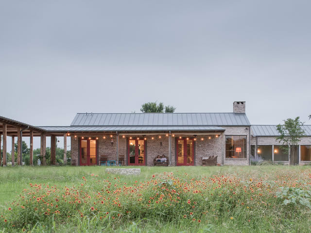 Vintage texas fort inspires this new austin area ranch for Ranch style home builders in texas