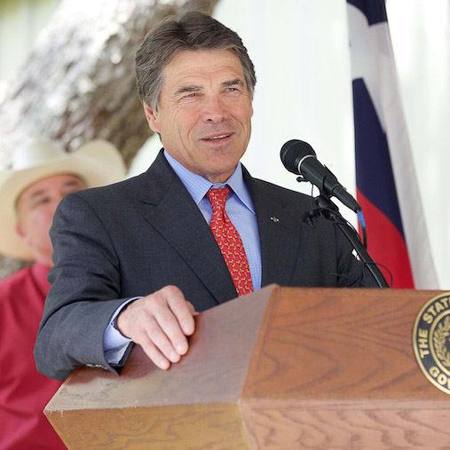 Rick Perry at mic and podium May 2013