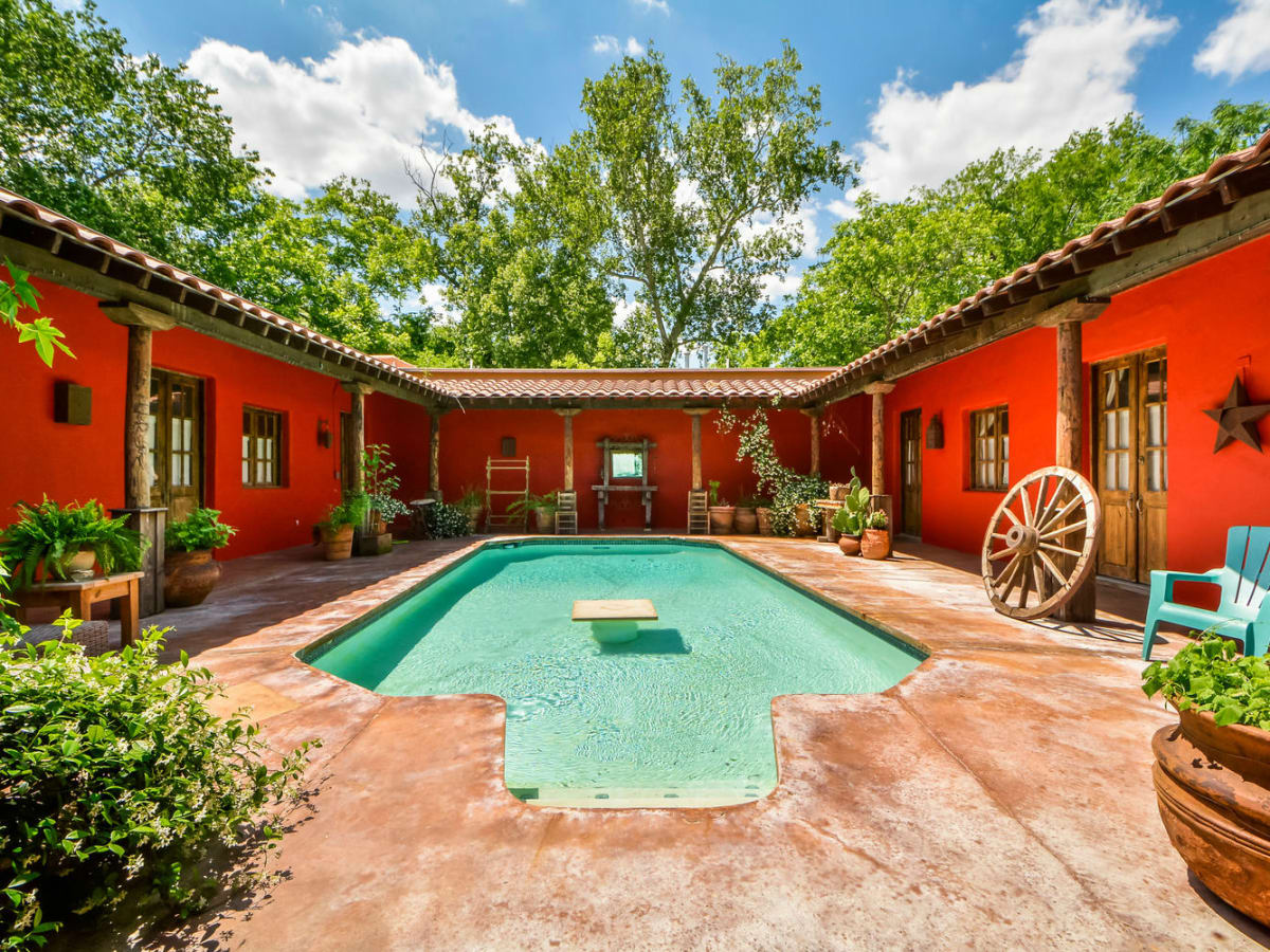 South austin hacienda offers one of a kind living in 78704 for Spanish style homes for sale in dallas tx