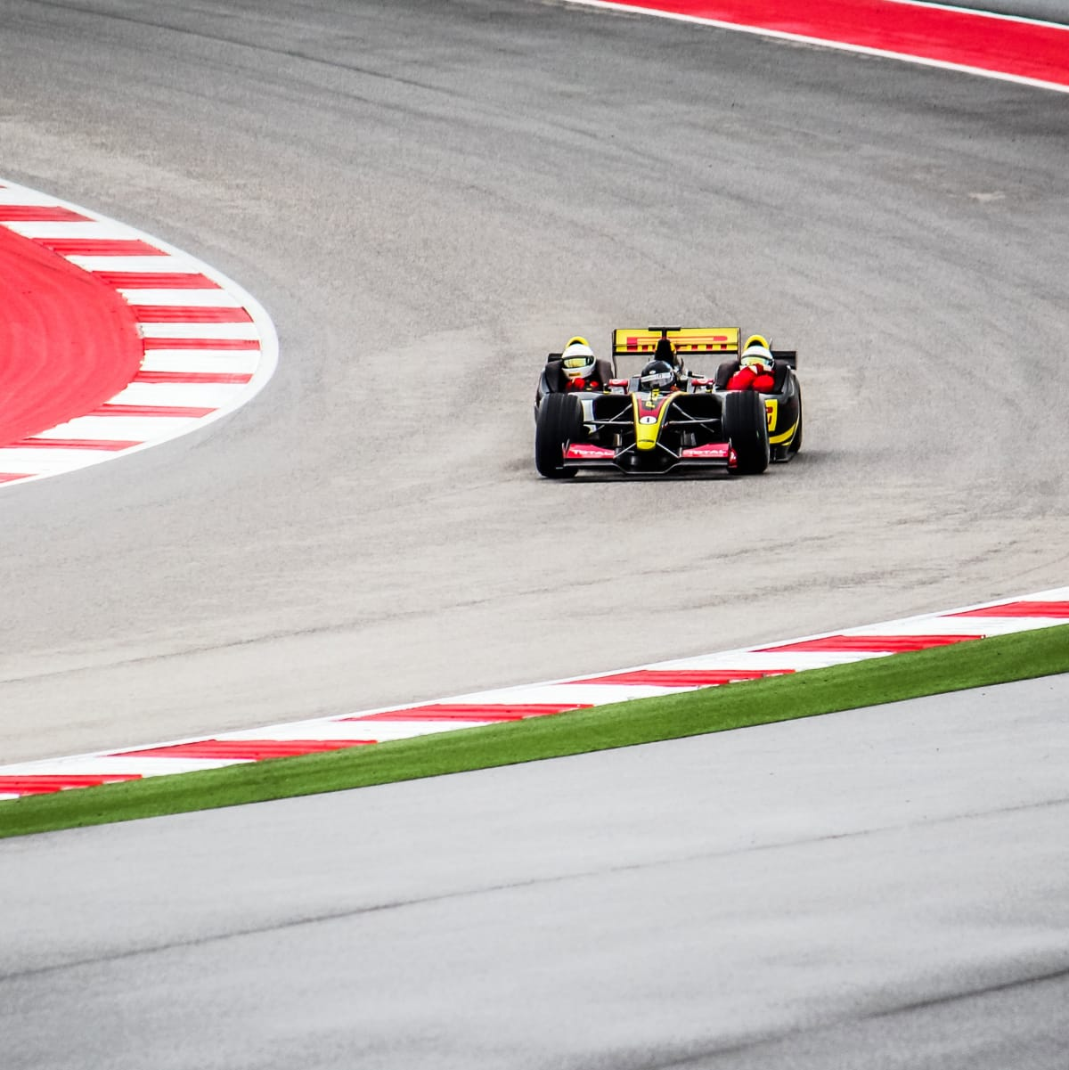 formula 1 ride along coming out of a turn for Ride Drive Give promotion