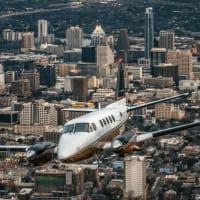 Envi Airways plane jet Austin downtown skyline